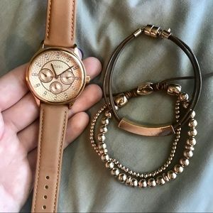 Gold/leather Fossil watch with accenting bracelets